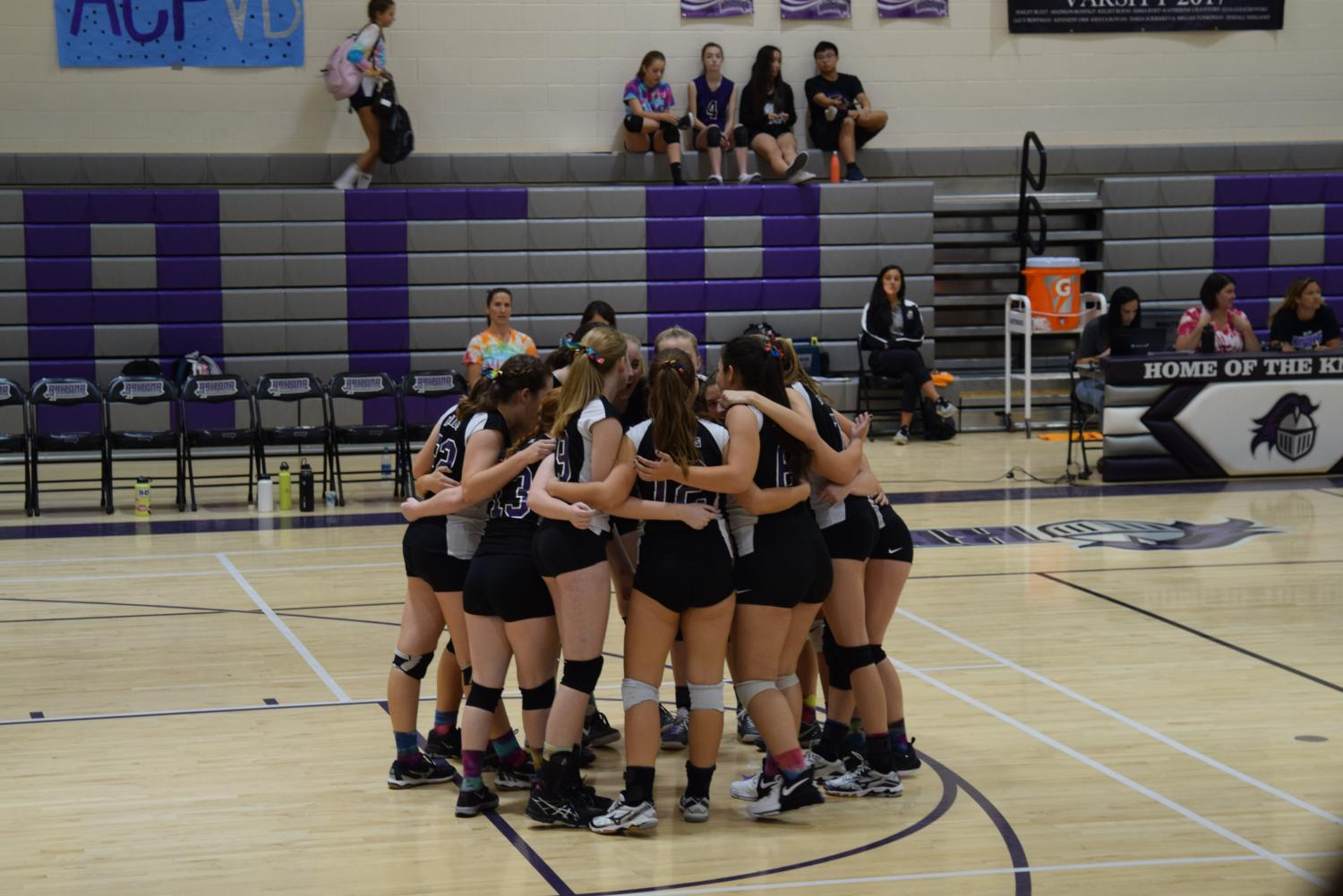 Game time! The Knights huddle before their game Monday night against Santa Cruz Valley. ACP would go on to win in 3 sets on Madi Bonfigt night.