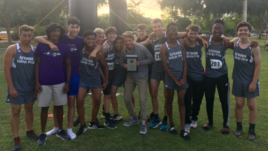 The Boys Cross Country team celebrates their victory at the meet.