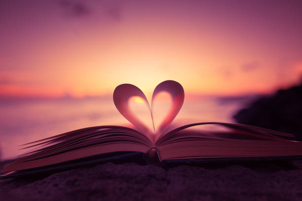 Heart+from+a+book+page+against+a+beautiful+sunset.